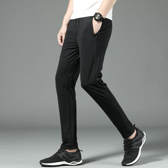MRMT 2020 Brand Summer  Men's Trousers Casual Slimming High Stretch Thin Pants for Male Hollowed Trouser