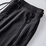 MRMT 2020 Brand Summer Men's Trousers Ultra-thin Ice Silk Hollowed Pants for Male Casual Closing Trouser