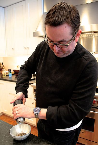 Chef Todd Stein grinding the Reluctant Tellicherry Peppercorns.