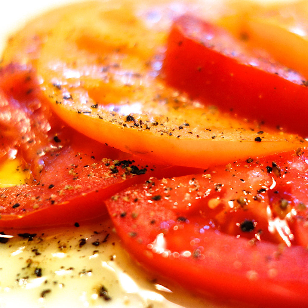 Farmer's market tomatoes sprinkled with Reluctant Trading Tellicherry Pepper, Icelandic Sea Salt and EVOO. Yum!