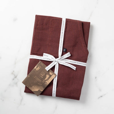 Burgundy Apron Packaged for Gift Giving in Reluctant Trading Printed Cloth Tape
