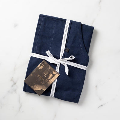 Navy Apron Gift Packaged in Reluctant Trading Fabric Tape