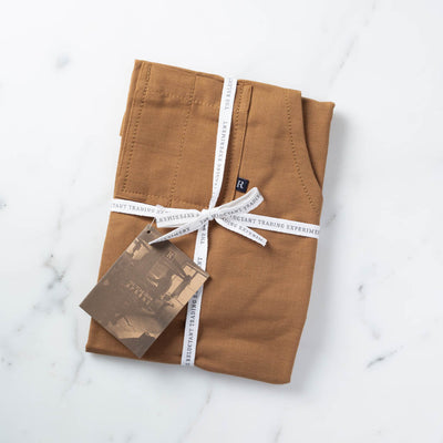 Ochre Apron Packaged for Gift Giving in Reluctant Trading Cloth Tape