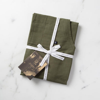 Olive Green Apron Packaged for Gift Giving in Reluctant Trading Cloth Tape