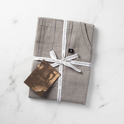 Tan Beige Apron Packaged for Gift Giving in Reluctant Trading Cloth Tape