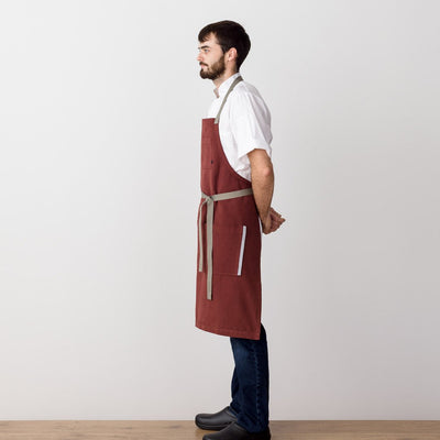 Chef's Apron, Maroon with Tan Straps, Men or Women, Model side view-The Reluctant Trading Experiment