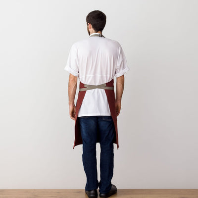 Chef's Apron, Maroon with Tan Straps, Men or Women, model rear view-The Reluctant Trading Experiment
