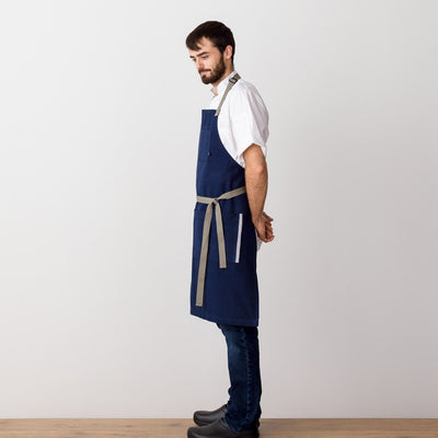 Chef's Apron, Navy with Tan Straps, Men or Women, side view model-The Reluctant Trading Experiment