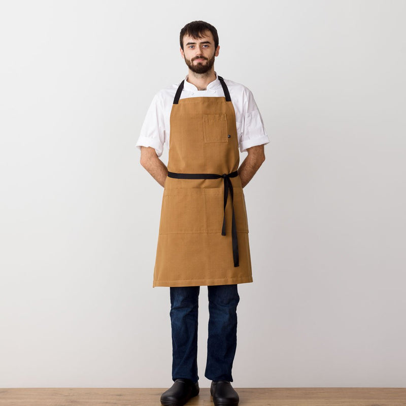 Chef's Apron, Ochre with Black Straps, Carhartt color, Men or Women, model front view-Reluctant Trading