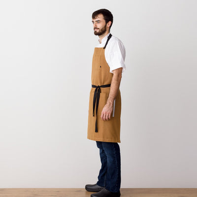 Chef's Apron, Ochre with Black Straps, Carhartt color, Men or Women, model side view-Reluctant Trading