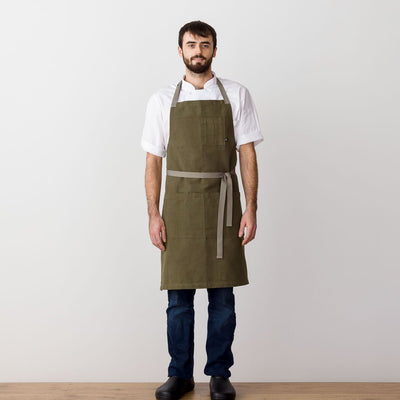 Chef's Apron, Olive Green with Tan Straps, Men or Women, model front view-The Reluctant Trading Experiment