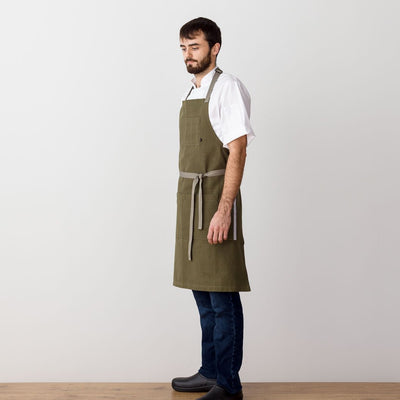 Chef's Apron, Olive Green with Tan Straps, Men or Women, model side view-The Reluctant Trading Experiment