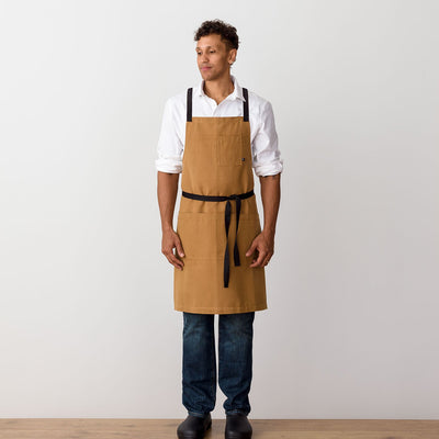 "Cross-Back Chef Apron, Ochre with Black Straps, Men and Women-[Reluctant Trading Experiment]-Standard Cross-Back - 34""L x 30""W"