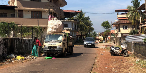 overloaded garbage truck
