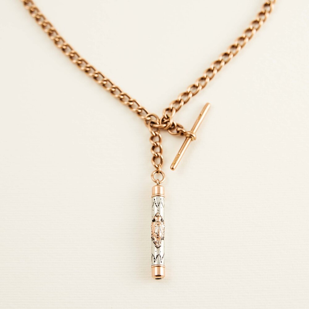 Silver and Rose Gold Continental Pencil Pendant