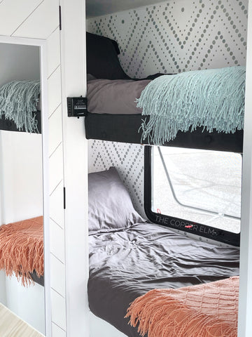 Camper bunk beds renovated in bright white walls with Cutting Edge Stencil designs painted in gray
