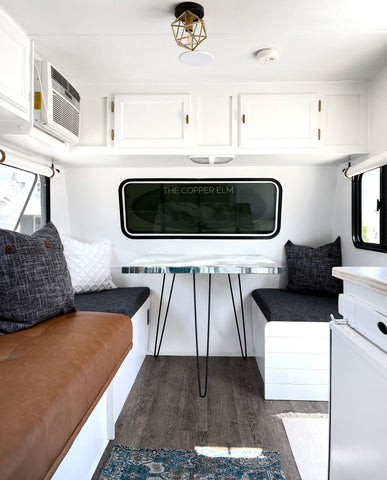 Camper renovation dining area with paint pour table