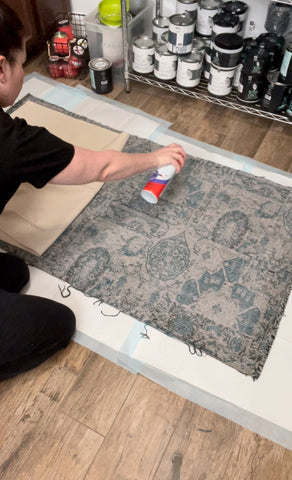 Spray adhesive to hold fabric to drop cloth for diy rug