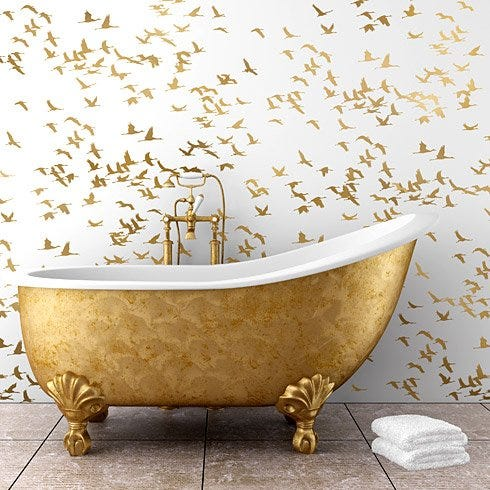 Cutting Edge Stencils Cranes in gold and white bathroom