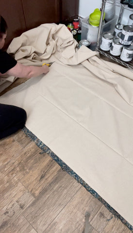 Cutting canvas drop cloth for DIY rug