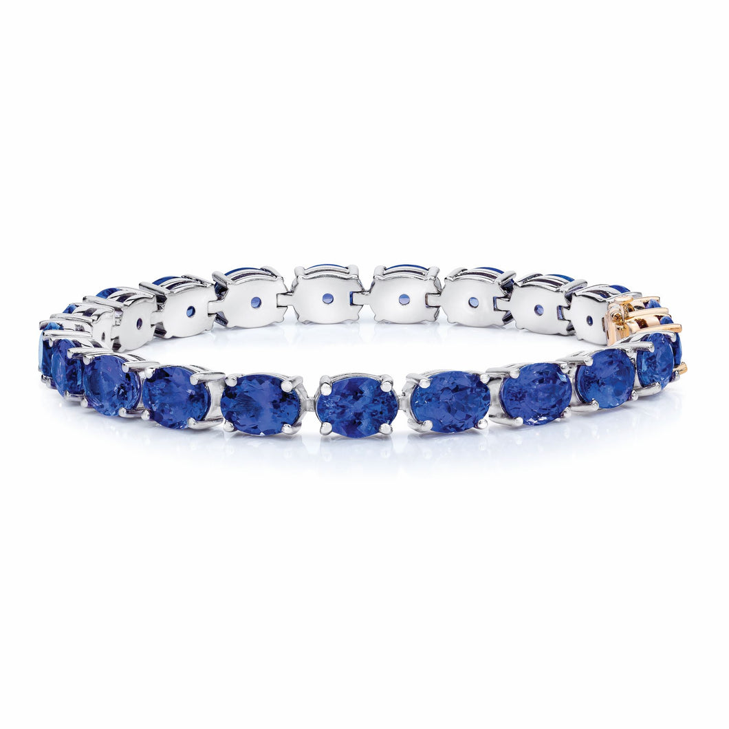 Oval Shaped Tanzanite Bracelet set in 925 Silver with a 14k Yellow Gold Lock