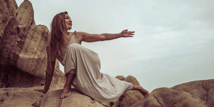 Sakti Rising ethical sustainable apparel; woman reaching out arm in joy