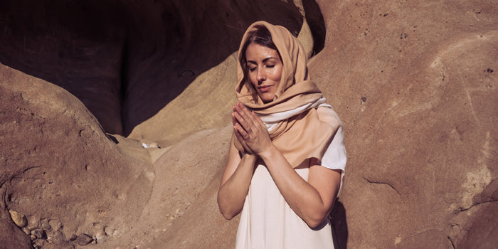 Sakti Rising ethical sustainable yoga apparel; woman in headscarf offering prayer