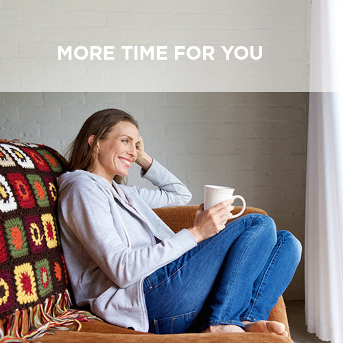 woman sitting on couch with coffee