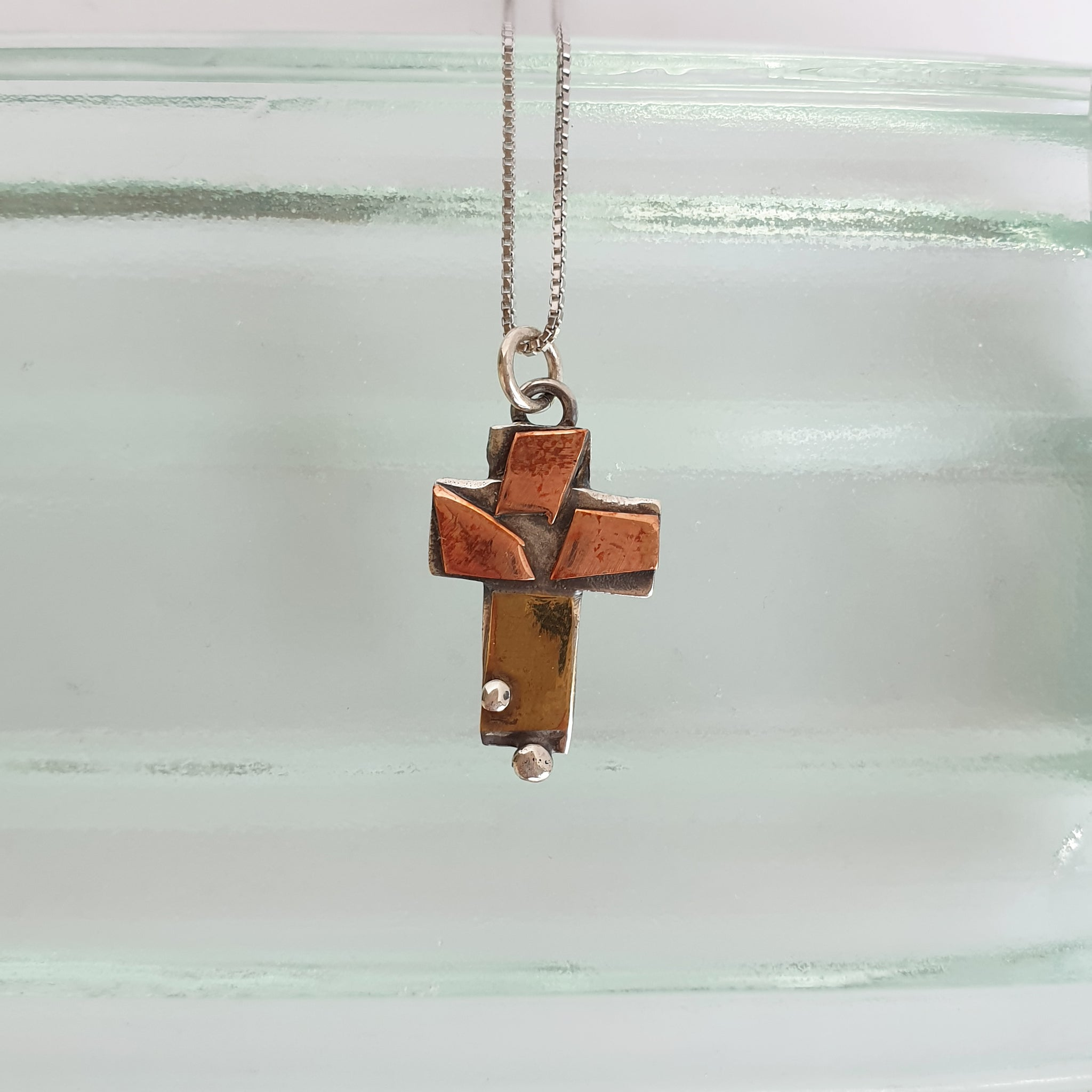 Silver, brass and copper cross