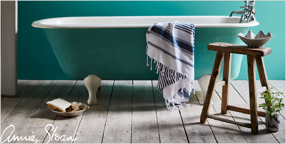 Bath tub with towel hung over the side