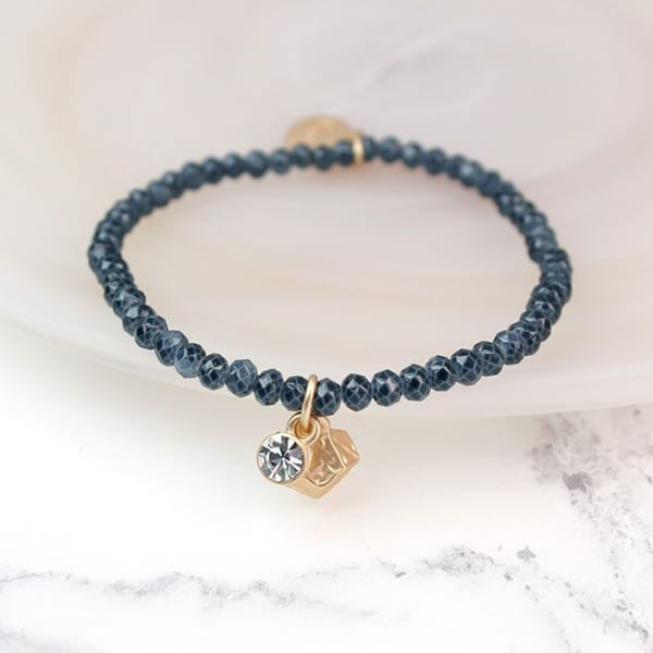 Grey Bead Crystal And Gold Charm Bracelet