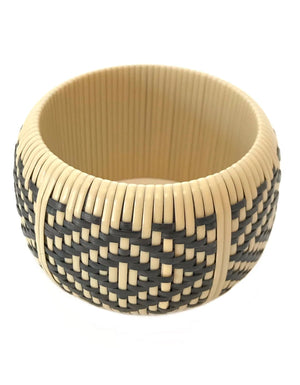 The Jetta Bangle in Natural Rattan.