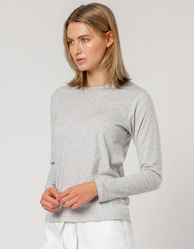 Ava Long Sleeve Tee in Grey Marle. The Ava Long Sleeve Tee by Nude Lucy is a staple for every wardrobe.  Crafted from a luxe cotton jersey, this tee features a crew neckline, long sleeves, and is a regular fit.