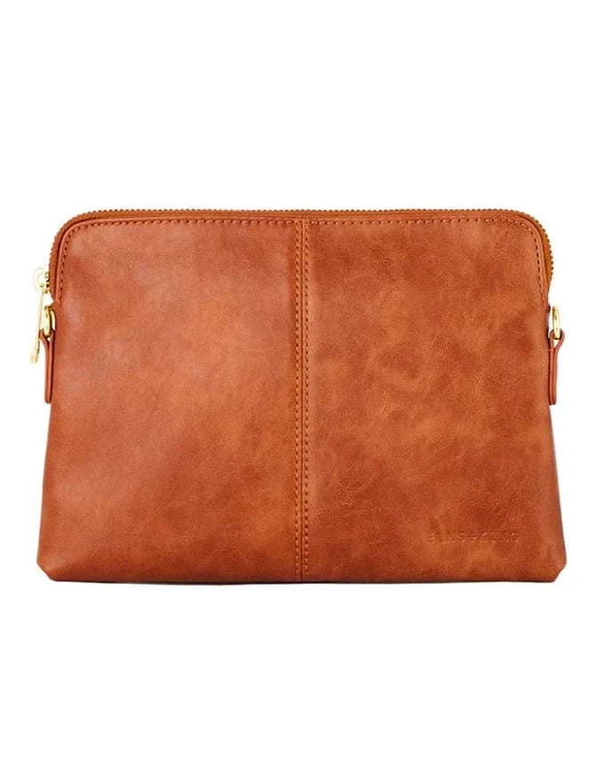 The Bowery Wallet is so much more than just a wallet! With its detachable and adjustable strap, this piece can be used as a clutch, shoulder bag or cross body bag!