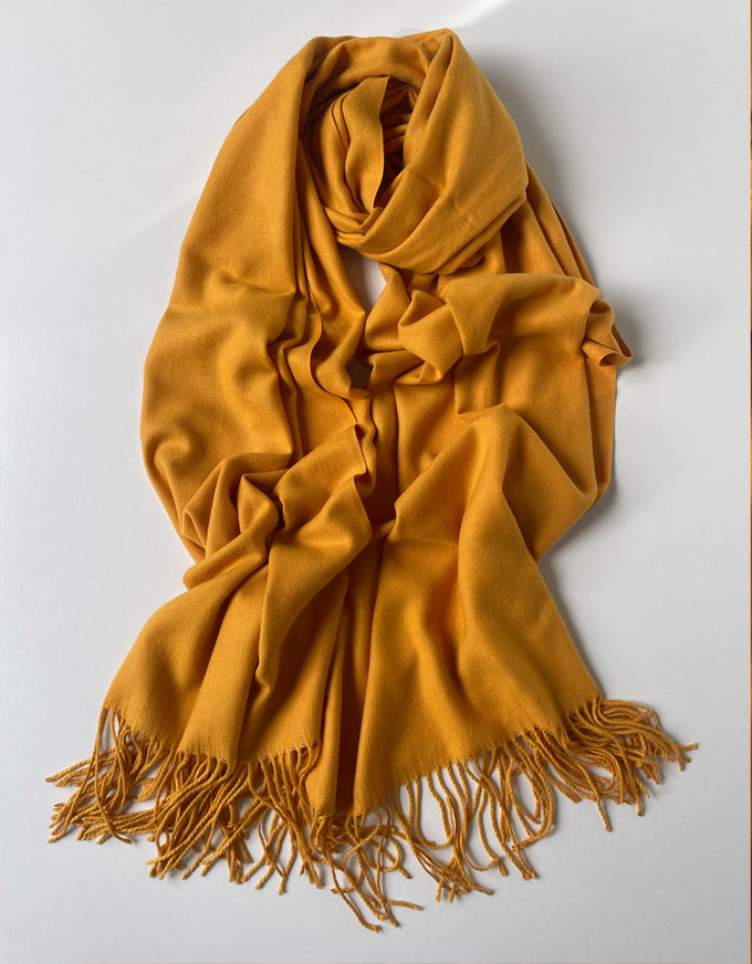 The Cashmere Scarf in Mustard.  A beautiful soft cashmere scarf, with fringed ends.