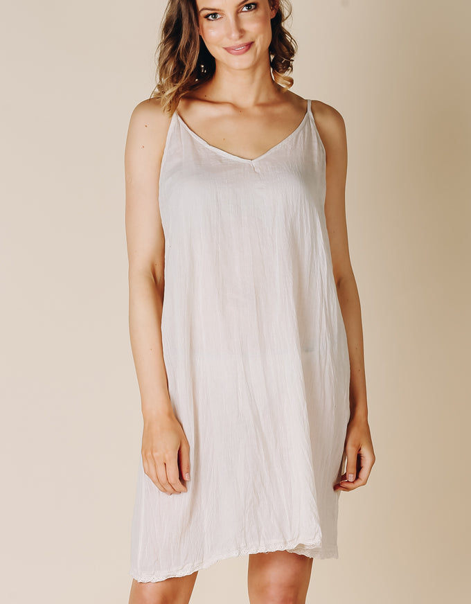 The perfect basic slip to layer under any sheer dress.
