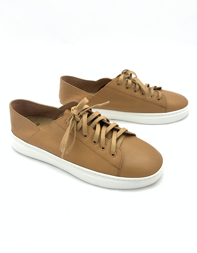 The Oskher Sneakers in Tan Leather.  Lend an on-trend feel to casual looks with this chic pair from Mollini.  Based on a sporty sneaker sole, Oskher is crafted from soft leather, with a lace-up front panel for convenience.