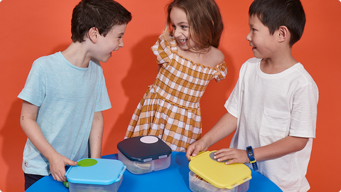 kids playing indoor with mini lunchbox - b.box for kids