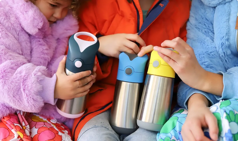 kids holding insulated drink bottles