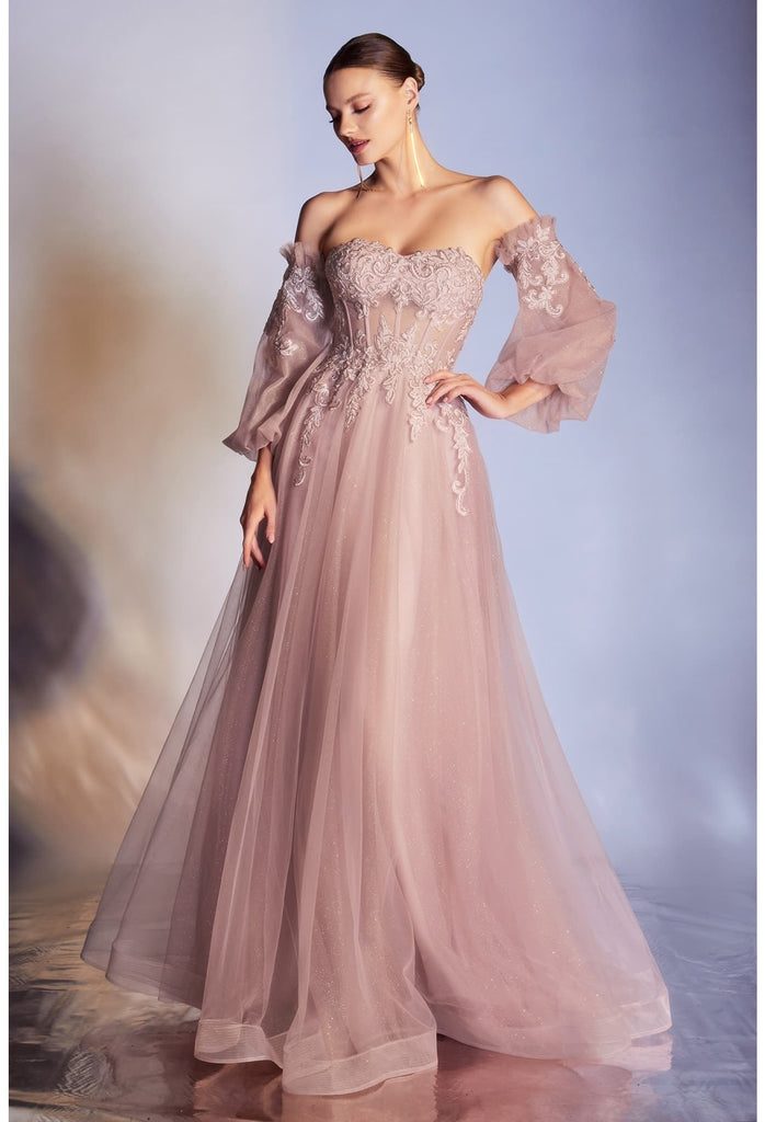 Cut from layers of glittered tulle, this ethereal princess-like gown features a sheer tulle corseted bodice, detachable off-the-shoulder blouson sleeves, and a lightly gathered skirt with flowing proportions. The bodice is strategically embellished at the bust, waist and sleeves. Its strapless sweetheart neckline is softened with a hand-cut lace edge.