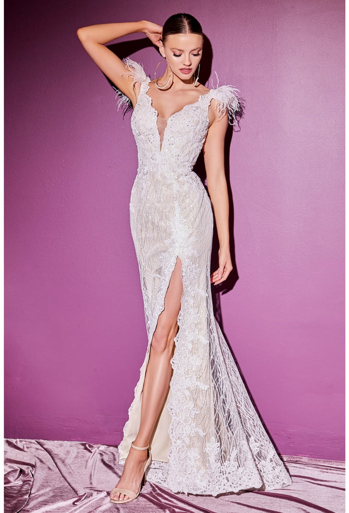 When a bride has an elevated sense of style, you have to offer something truly breathtaking. This gorgeous sparkly gown features lace applique with white glitter novelty mesh underlay with stretch nude lining. Feather accent at the shoulder is truly unforgettable and modernized with a deep plunging neckline. Scalloped lace edge detail adorns the leg slit & the V-shaped back bodice.