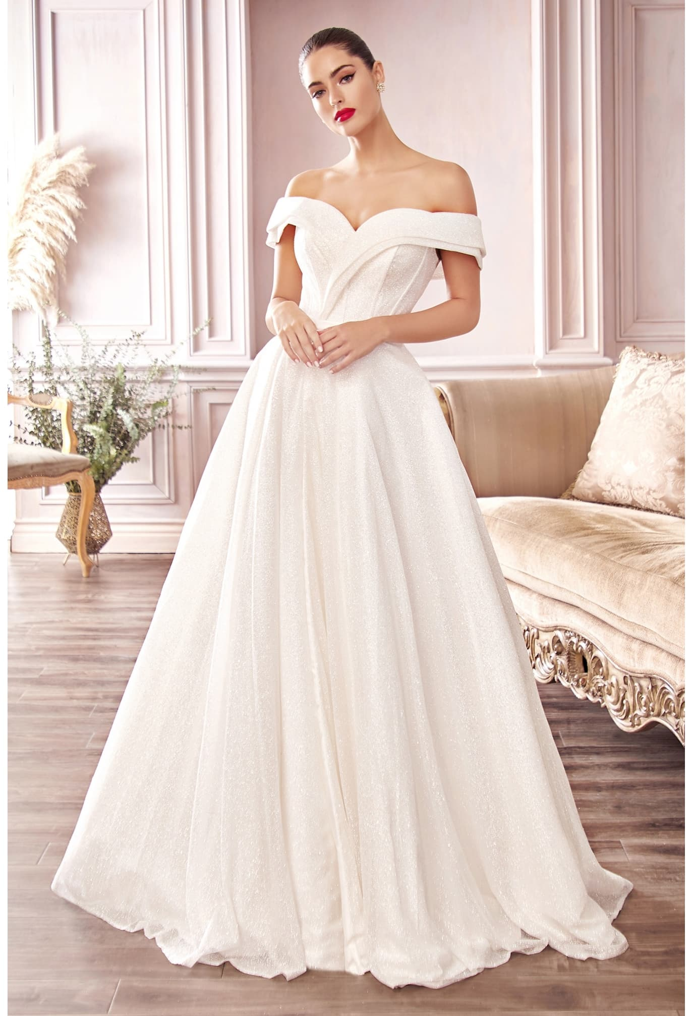 CD214W GLITTER OFF THE SHOULDER BALL GOWN Designed into a strapless silhouette with a fitted bodice and floor sweeping A-line skirt, this gorgeously crafted glitter gown will have you looking and feeling like royalty on your special day.