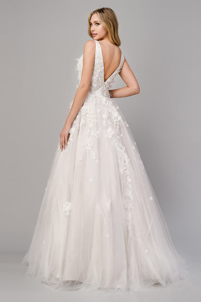 A1028W GARDENIA WEDDING GOWN Gardenia gown is a layered tulle ball gown with floral diamond glitter motif trickling down the gown. 3D organza flowers add couture depth to the garment, shimmering diamond florals shine against the French beige lining.