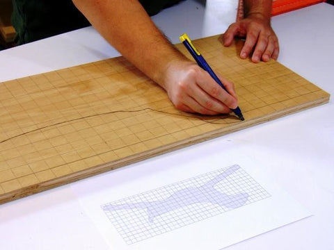 Drawing Designs on Wooden Hand Blocks