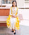 White Tasseled Dress With Yellow Waterfall Shrug