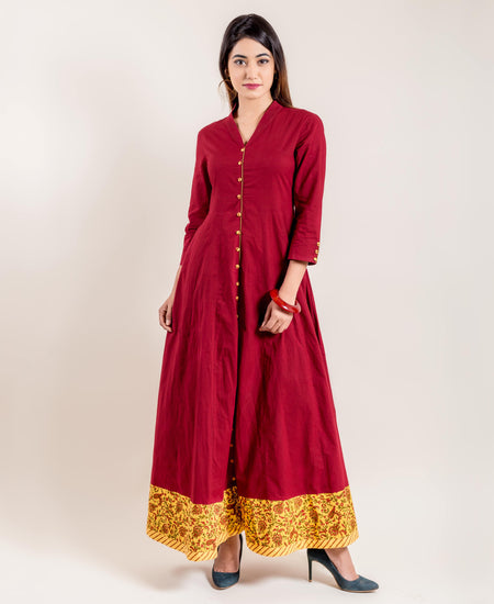 Anarkali Style Gown With Fancy Buttons In Rust Hue