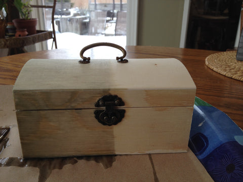 Paint the antique wooden treasure box with kid-safe weathered wood finish