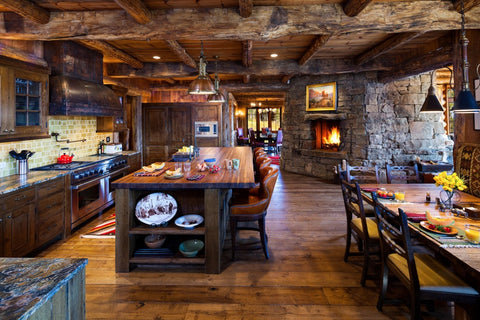 Stonewall and weathered wood finish in a beautiful rustic kitchen. Source: http://freshome.com/2014/07/23/10-rustic-kitchen-designs-that-embody-country-life/