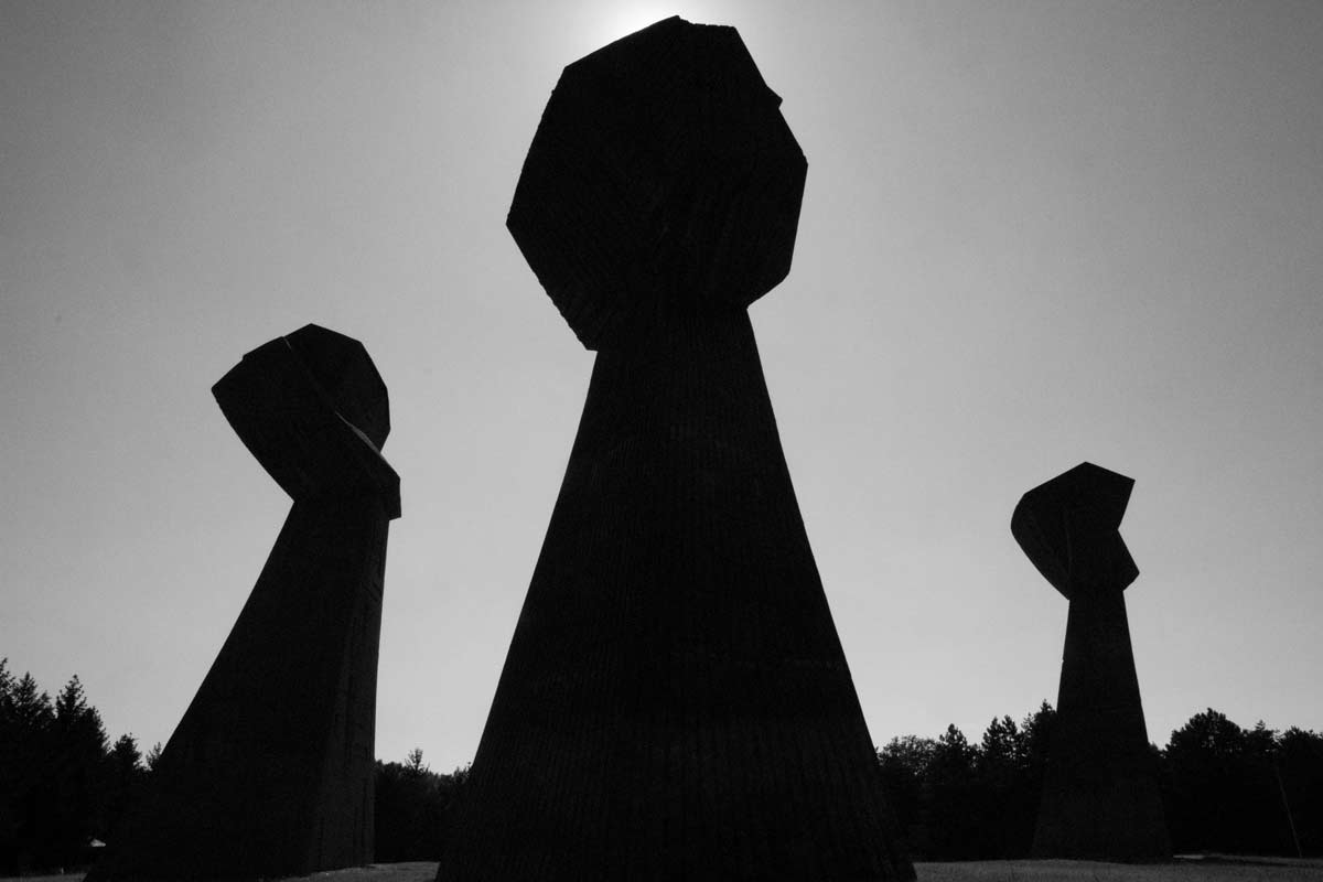 Monument of the three fists shadown Serbia The quiet before the travel