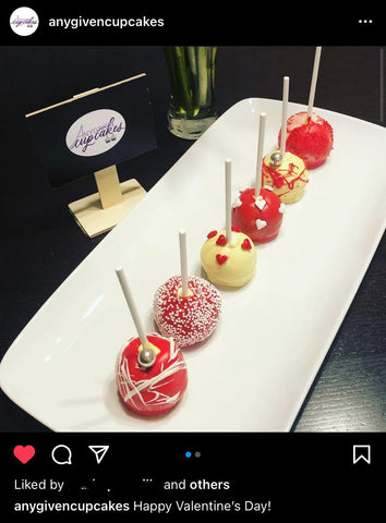 Any Given Cake pops with the custom logo stickers on display